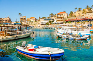 Mediterranean Jbeil port lagoon with anchored fishing boats, Byblos, Lebanon